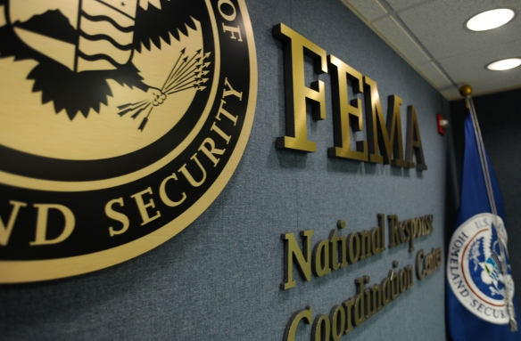 Washington, DC, June 4, 2009 -- Part of the DHS seal, the FEMA logo and the DHS Flag, on the wall in the National Response and Coordination Center. FEMA/Bill Koplitz