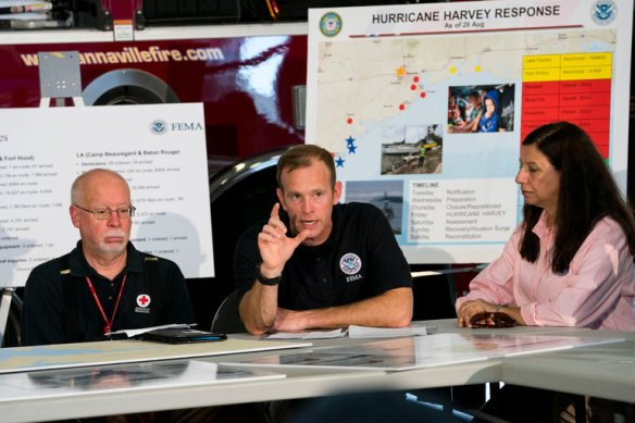 Brock Long, center, at a briefing on Hurricane Harvey relief efforts with President Trump and local organizations in Corpus Christi, Tex., last week. Credit Doug Mills/The New York Times