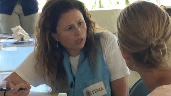 Teri Villarreal, usually an import specialist with CBP's Rosemont, Illinois, office, helps residents of the U.S. Virgin Islands as a member of FEMA's Surge Capacity Force. FEMA photo by Kevin Sur