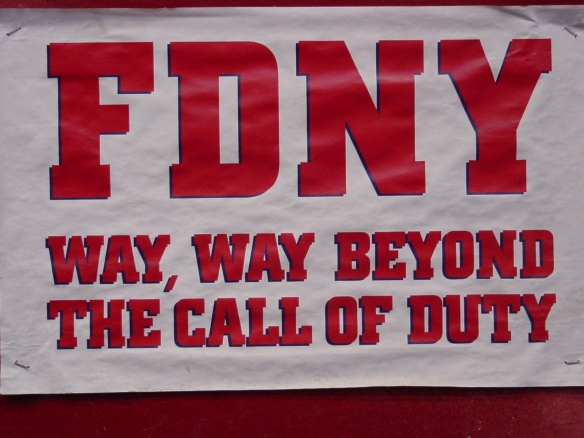 "Sign at FDNY Engine 10 Ladder 10 house ""FDNY WAY, WAY BEYOND THE CALL OF DUTY"""